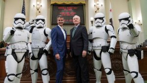 CA Assembly Members standing with storm troopers in the capitol