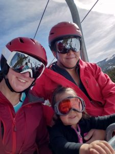 Dawn, her husband and daughter on a ski lift